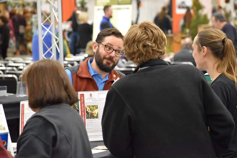 Image of a person answering a question and a trade show booth